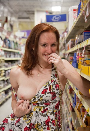 Crazy amateur redhead Dee Dee Lynn flashes her tits and red panties in public