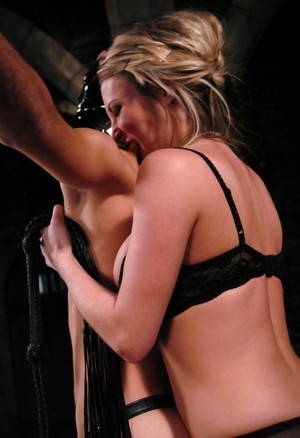 Masked slave gets dominated by Harmony who's wearing black lingerie