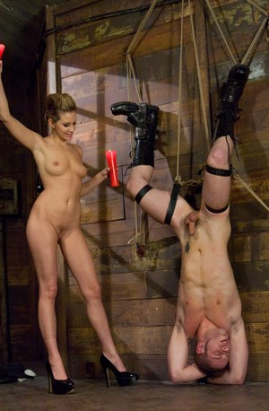 Nude lady Maitresse Madeline Marlowe tortures a man with wax in stiletto heels