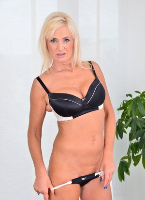 Mature blonde Roxana Hanova does an amazing striptease performance