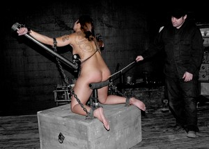 Asian hottie DragonLily gets pleasured by her master while in metal bondage