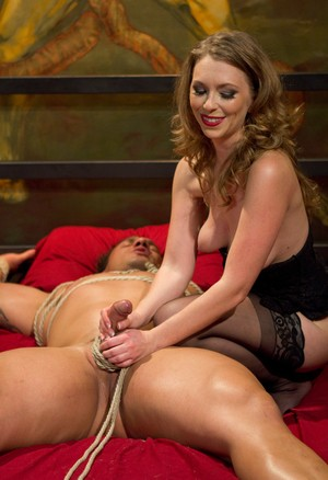 Guy bound in rope gets dominated by Mistress T who's wearing black stockings