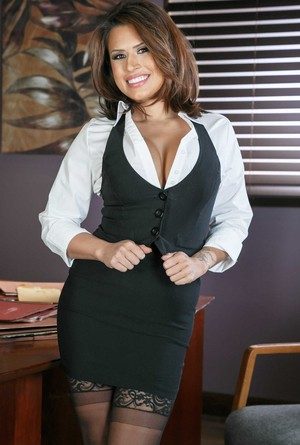 Lusty secretary Eva Angelina strips down to her stockings at the office