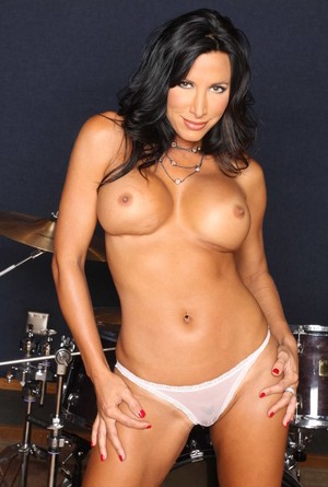 Brunette solo model Lezley Zen takes off her clothes in a recording studio