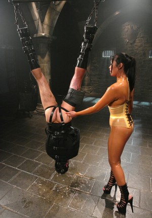 Guy hangs upside down while he is dominated by Mika Tan in her dungeon