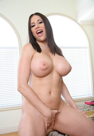 Hot Latina lady Sheila Marie uncovers her hooters as she gets naked on her bed
