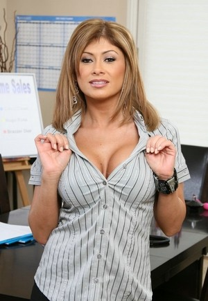 Busty boss Lisa Daniels with tanned body takes off clothes solo in office