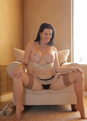 Mature beauty Licious Gia wears stockings while using a toy on her pussy