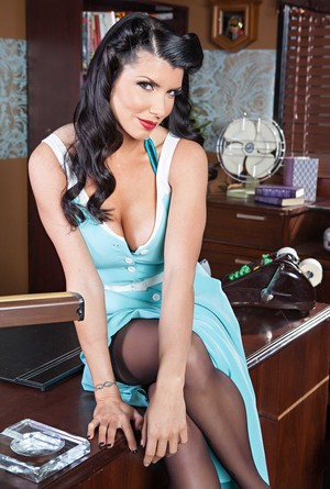 Brunette headmistress Romi Rain with inked back teases pussy in office
