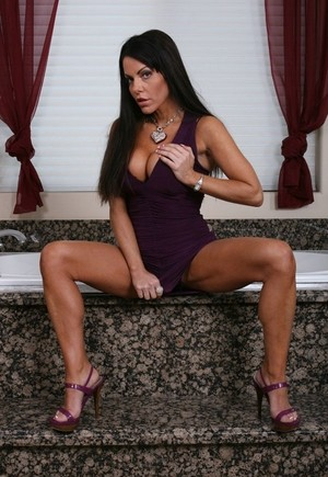 Glamour brunette Victoria Valentine with perfect tan takes off tight dress