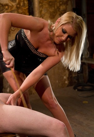Ashley Edmonds dominates a guy in her dungeon before she sucks some dick