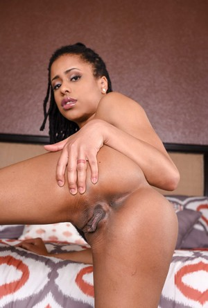 Long-legged chocolate Kira Noir shows off enticing pussy and asshole solo