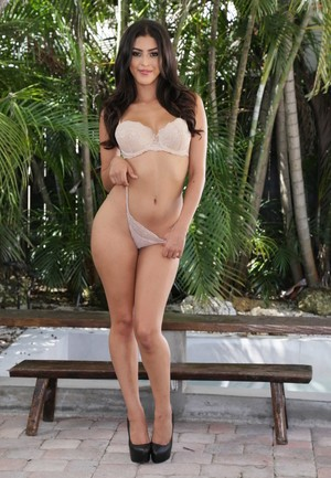 Latina solo model Sophia Leone works her way free of a tight dress
