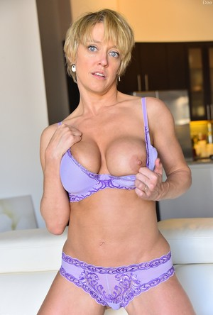 MILF Dee displays her fake tits before she stretches her asshole