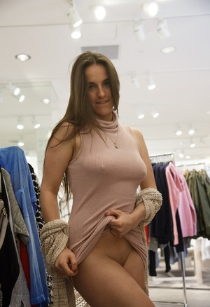 Shameless chick Nina Gitch flashes big boobs and pussy in public places