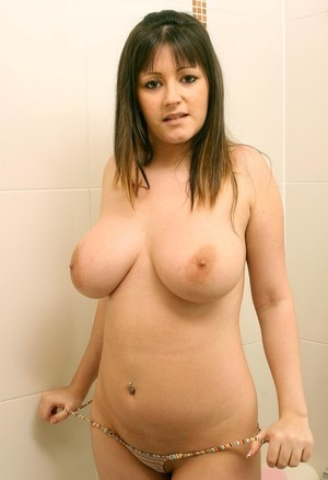 Teenage slut Abi B strips down naked and washes her big natural breasts