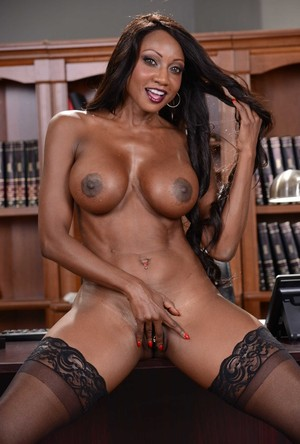 Black business woman Diamond Jackson strips to her stockings atop her desk
