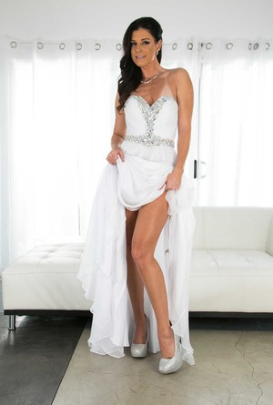 Aged brunette MILF India Summer slips off her long dress to model in underwear