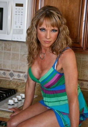 Curly-haired housewife Shayla Leveaux has nude photo session in kitchen
