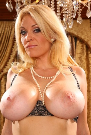 Full-bosomed mom Charlee Chase in stockings drops some naughty glances