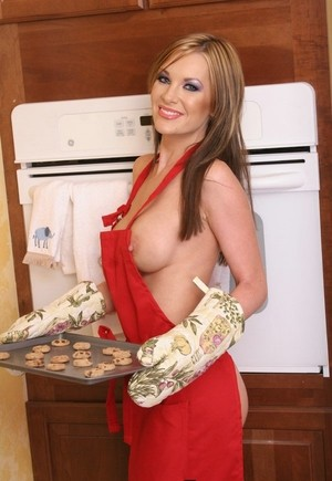 Busty housewife Brandi Edwards fleshes her goodies while baking in the kitchen