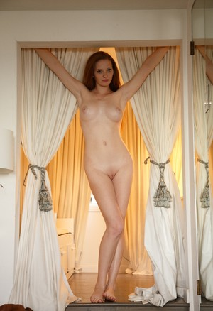 Pale redhead Wendy Patton exposes her huge breasts during solo poses