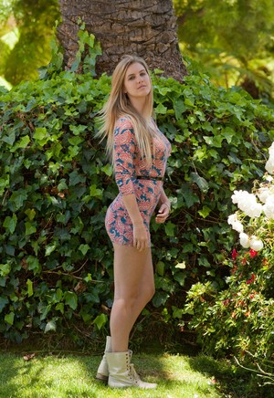 Blond exhibitionist Holly Benson flashes her panties and ass in a public park