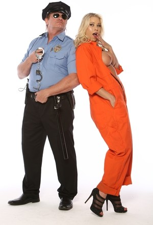 Blonde inmate Katie Morgan exposes her big boobs to a policeman