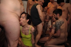 Two divas compete in who is a better cock sucker at a crazy gangbang