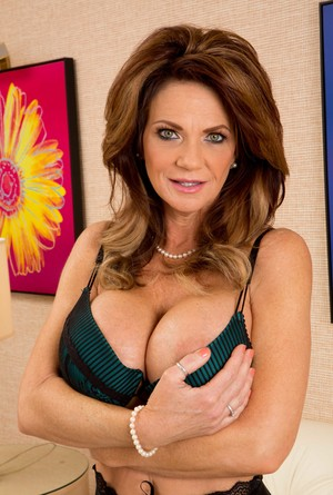 Older lady Deauxma exposes her huge tits prior to fingering her moist pussy
