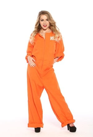 Female prisoner with dirty blonde hair releases her small boobs from jumpsuit