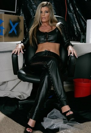 Famous MILF Kristal Summers reveals her big juggs and pussy in leather outfit