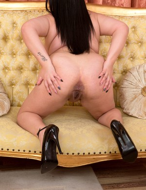 Dark haired BBW Katie Black plays with her pussy after lingerie removal