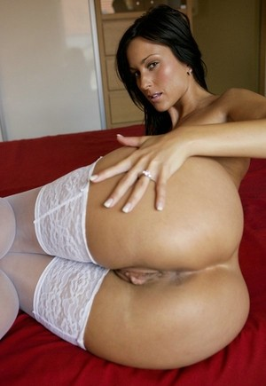 Exotic brunette Simone Peach displays her an amazing ass in white stockings