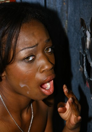 Black woman Cocoa Chanel looks great sucking white cock in gloryhole photos