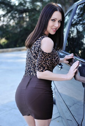 MILF RayVeness climbs in the car, bares her pussy, and fingers it a little
