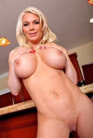 Huge titted housewife Diamond Foxxx getting naked in the kitchen