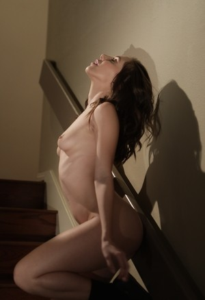 Horny brunette Jenna Sativa plays with her yummy trimmed pussy on the stairs