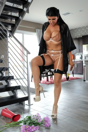 Dark haired wife Romi Rain struts and tromps flowers in sexy nylons and heels