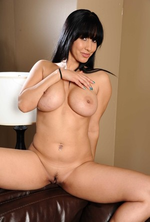 Brunette lady vamp with beautiful big boobs Isis Love spreads pussy lips