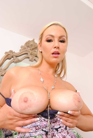 Abbey Brooks bares natural boobs and elegantly trimmed pussy in her cozy room