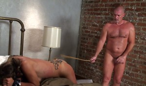 Naked chick is bagged and restrained before being caned and mouth fucked