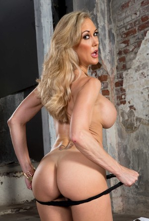 Beautiful MILF Brandi Love takes her dress off and plays with her meaty cunt