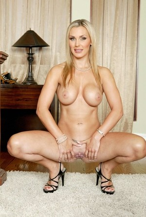 Fabulous MILF Tanya Tate proudly shows her big breasts and hot twat