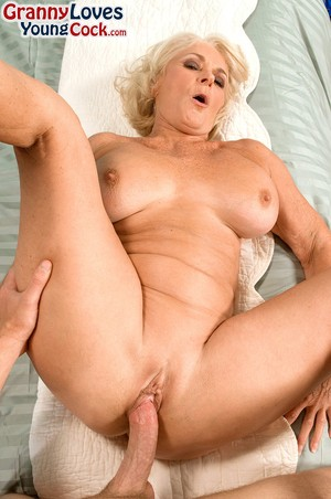 Busty blonde cougar Georgette Parks gets screwed and facialed by a cute stud