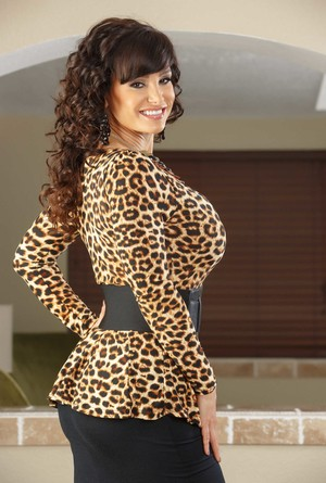 Brunette female Lisa Ann doffs a black skirt on way to nude poses