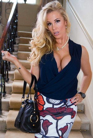 MILF Rebecca More comes home after shopping and strips right on the stairs