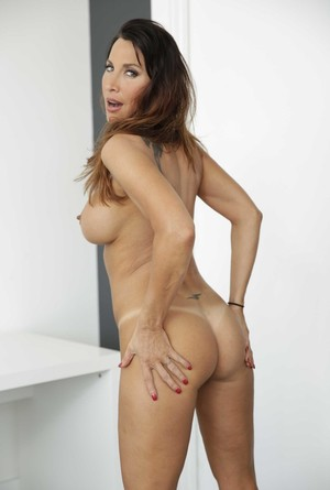 Solo model Lezley Zenslips out of her short dress for nude poses