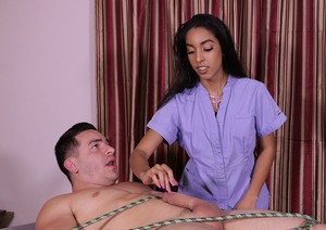 Hot lady Claire Black ties man to the massage table and gives teasing handjob
