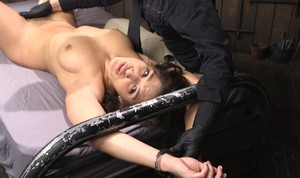 Brunette female Abella Danger is masturbated against her will in chains